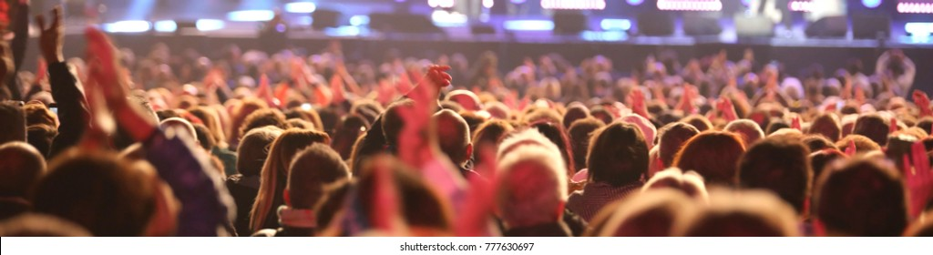 many guys and girls of the audience during live concert from the pop star outdoors