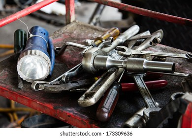 Many hand tools in car garage