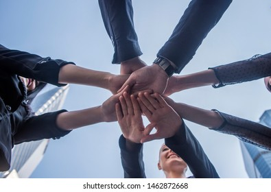 Many hand of young business people join  team work out office . this hand of group corporate mix partnership multiple ethnicity. Corporate Meeting Teamwork Concept