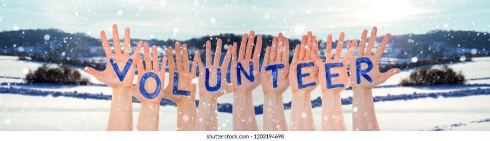 Many Hands Building Word Volunteer, Winter Scenery As Background