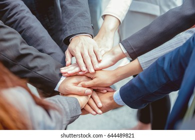 Many hands of business people concept. Everybody show the power in the office   promise to trust, respect, reliable and integrity in their work. The respect each other is very important to do big job