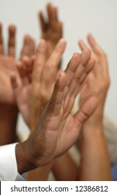 Many hands going up either in a question or during an election