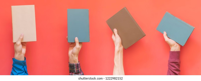many hands hold multiple books isolated on color surface concept