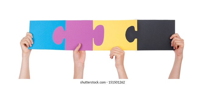 Many Hands Holding Colorful Pieces of a Puzzle, Isolated