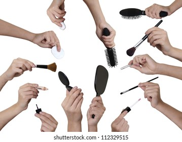 many hands holding different  make up equipment cut out on white background