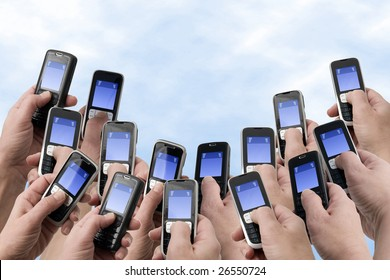 Many hands holding mobile phones with empty text message boxes