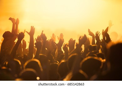 Many hands at a night disco show