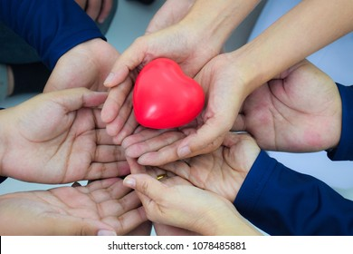 Many hands are power, energy, ideas, power, harmony. With a red heart on hand.
