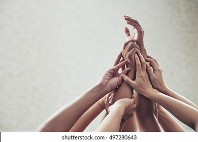 Many hands raised in the air: unity and support