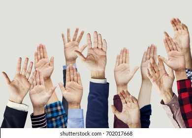 Many hands raised together
