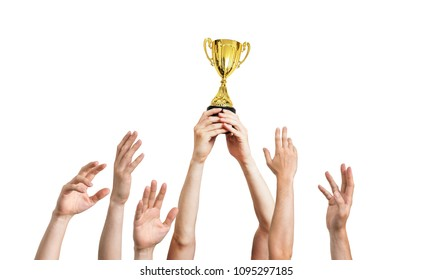 Many hands raised up. Winner is holding trophy in hands. Isolated on white background.