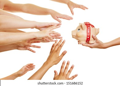 Many hands reaching for money in a piggy bank in a hand
