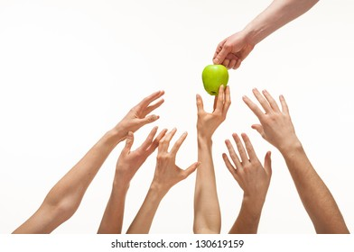 Many hands want to get apple, white background