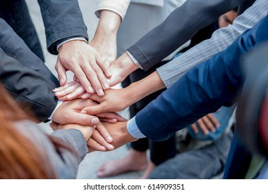 Many hands of young business  people join together concept. Everybody show power in the office  promise to  trust, respect, reliable and integrity in their work.