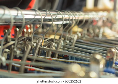 Many hangers in a row for clothes in the store