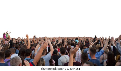 many happy people with raised hands at a concert or show