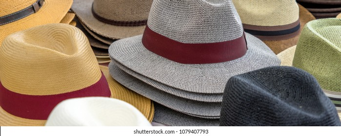 Many hats for men in different shapes and colors in one display for sale, germany