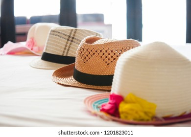 Many hats on bed