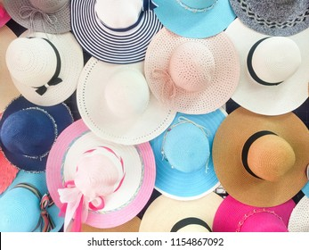 Many hats from the sun. Women's designer hats from the sun of different colors. Beach hats for summer, Design of women's beach hats.