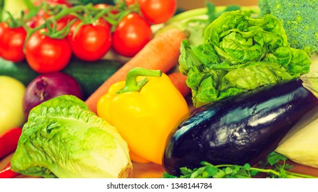 Many healthy colorful vegetables background. Dieting, vegetarian local fresh food, natural source of vitamins.