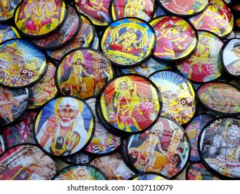 e5fc6bbdfd3 Many Hindu god goddess sai baba round wall photos heaped for sale at an  Indian road
