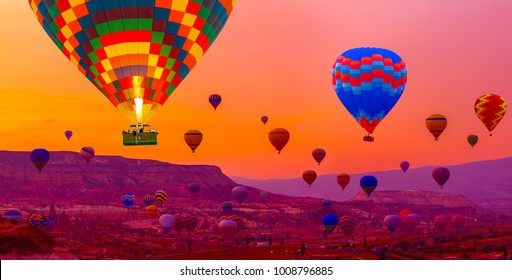 Many Hot air balloon flying over rocks formations valley panorama spectacular Cappadocia