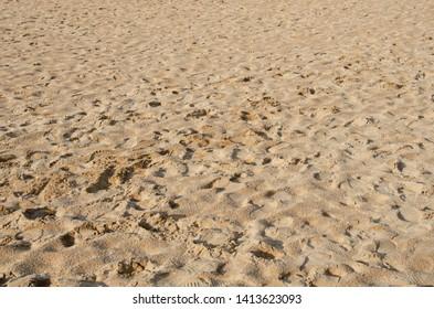 many of human footprint on the sand beach