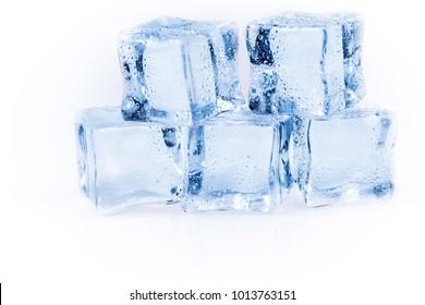 Many ice cubes on white reflection background