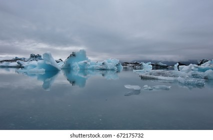 Many icebergs at midnight sun. The glacier lagoon in Jokulsarlon, South Iceland.