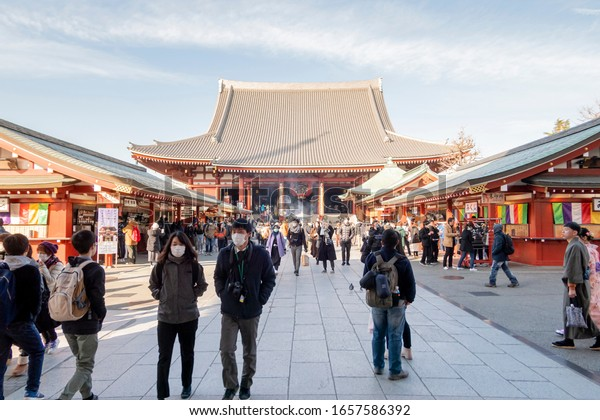 Many Japanese people walking at Asakusa temple while wearing masks to protect infection from Covid-19 virus which is spreading worldwide. Tokyo, Japan February 7, 2020