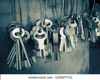 Many key chains for copy key on locksmith shop.