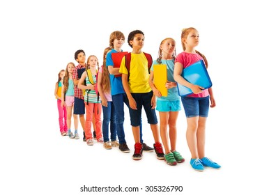 Many kids standing in line with books