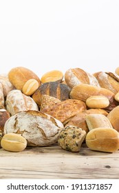 Many kinds and kinds of bread collected in one place on a wooden old shop counter as a decoration for a traditional bakery. White background from the top for self-completion.