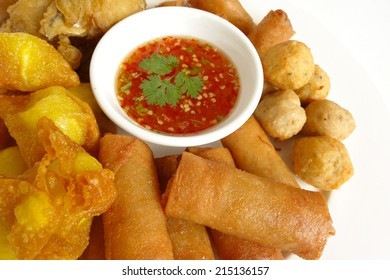 Many kinds of fried meatballs and sauce.