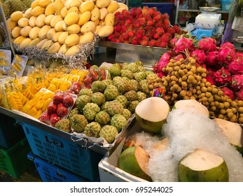 Many kinds of fruit were sold on the street side in Thailand night market all day long. Hua Hin Thailand June 25,2017