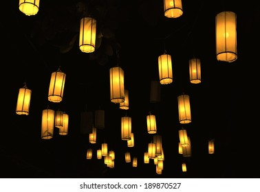 Many lanterns against the black sky.
