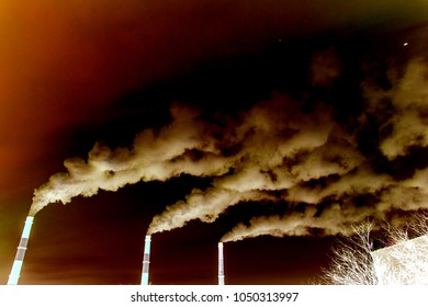 many large pipes of which goes dirty smoke, exhaust fumes and shepherds, above the city, the pollution of Wednesday