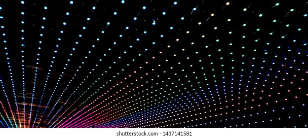 many led lights of many colors inside a tunnel