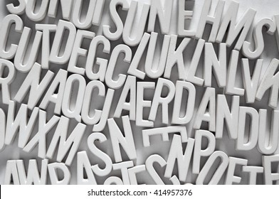 Many letters piled up together in an alphabet soup kind of array. Language concepts.