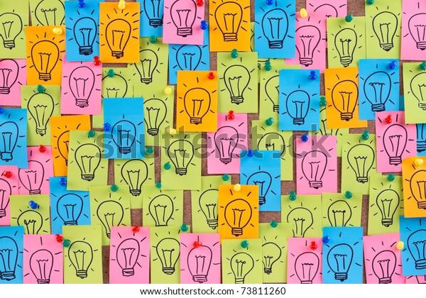 Many light bulb drawn on colorful sticky notes.