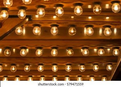 Many light bulbs shining bright. Plenty lightbulbs in rows on ceiling burn