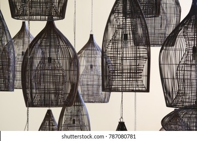 Many lights suspended. Silouhettes of hanging lamps. Illumination patterns in a modern style. Circular forms and lines.