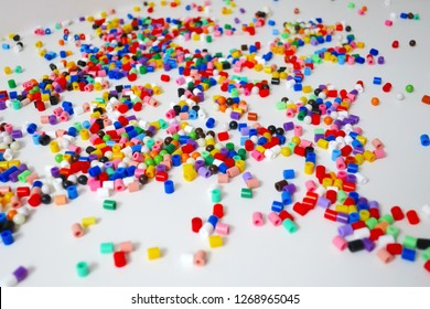 many little beads (perler beads) (Hama Beads) that are fusible when ironed, perfect for kids to use.