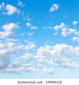 many little fluffy clouds in blue sky in summer