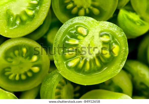 many little green coctail tomatos cut in half