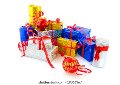 Many luxury wrapped christmas presents decorated with balls