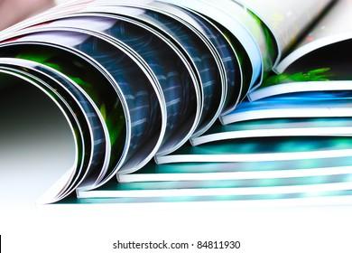 many magazines isolated on white
