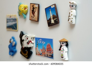 many magnets on the fridge