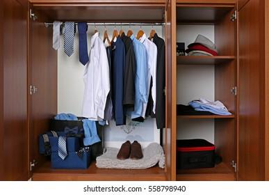 Many man's clothes in wardrobe, closeup