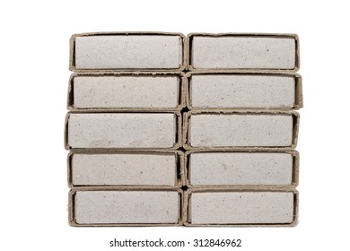 Many matchboxes on a white background in a row.